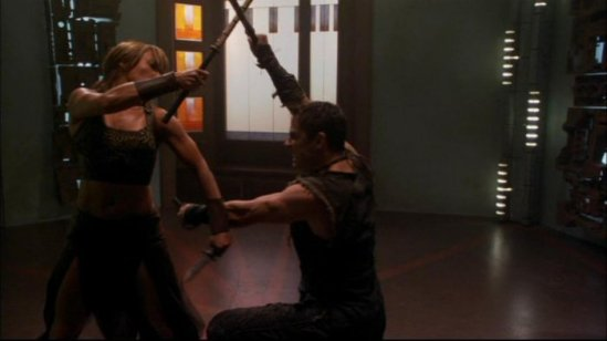 Teyla (Rachel Luttrell) and an Athosian (James Bamford) practicing their fight skills